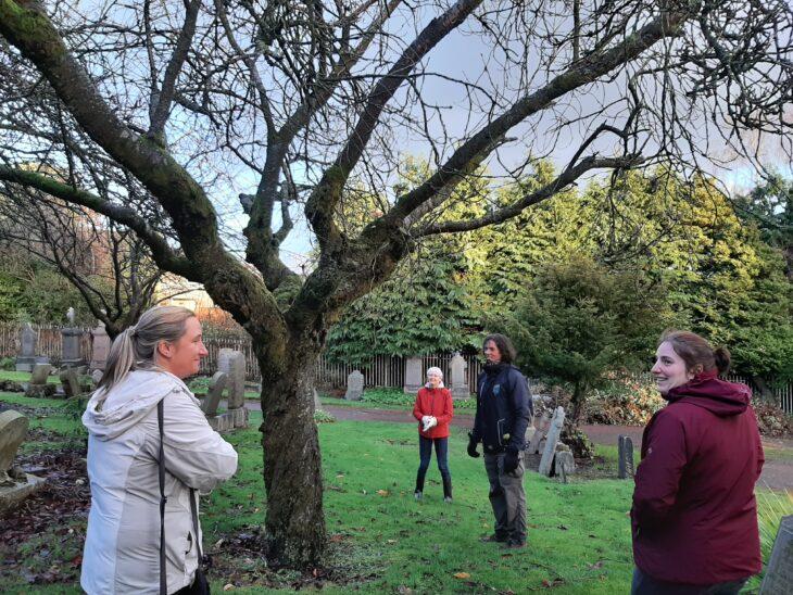 People looking at fruit tree